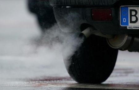 FILE PHOTO: Emissions well out of an exhaust in downtown Berlin.