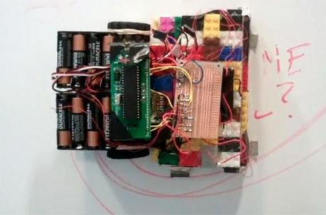 Cornell students build spider-like robotic chalkboard eraser out of Lego, magnets, fun (video)