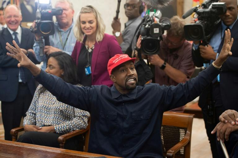 Rapper Kanye West, pictured October 2018 meeting with Donald Trump in the Oval Office of the White House, says he no longer supports the US president and is running for office himself (AFP Photo/SAUL LOEB)