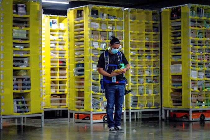 EASTVALE, CA - AUGUST 31: Amnesty technician Gustavo Morales controls logistics robots at Amazon fulfillment center in Eastvale on Tuesday, Aug. 31, 2021. (Photo by Watchara Phomicinda/MediaNews Group/The Press-Enterprise via Getty Images)