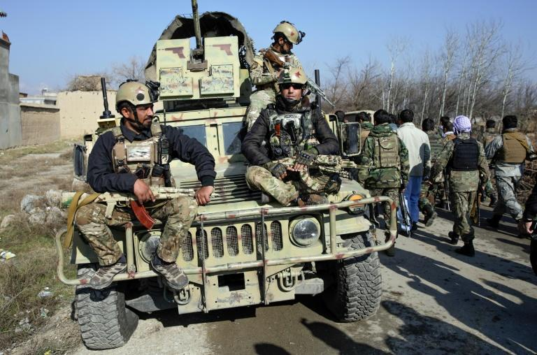 Afghan security forces arrive at the site of a car bombing near the largest US military in Afghanistan, north of Kabul in Parwan province, on December 11, 2019