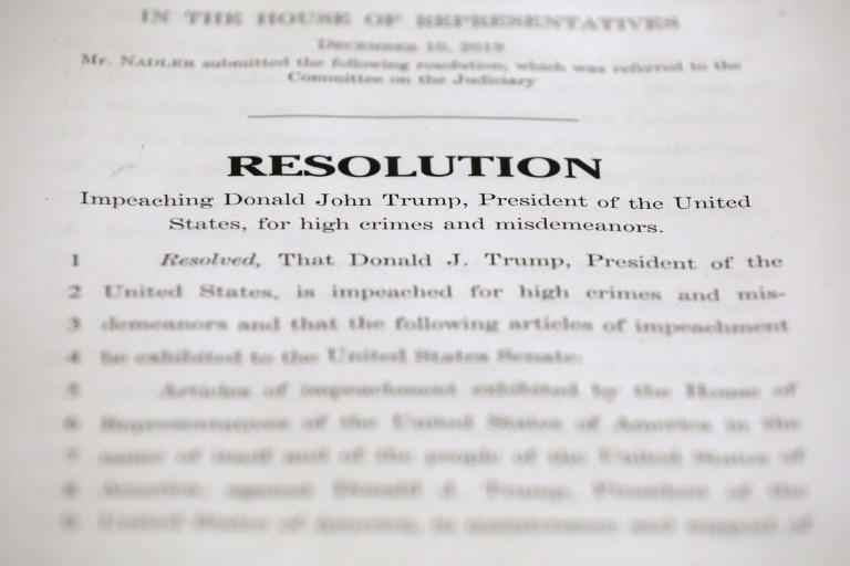 The first page of the House Judiciary Committee's two articles of impeachment against US President Donald Trump (AFP Photo/CHIP SOMODEVILLA)