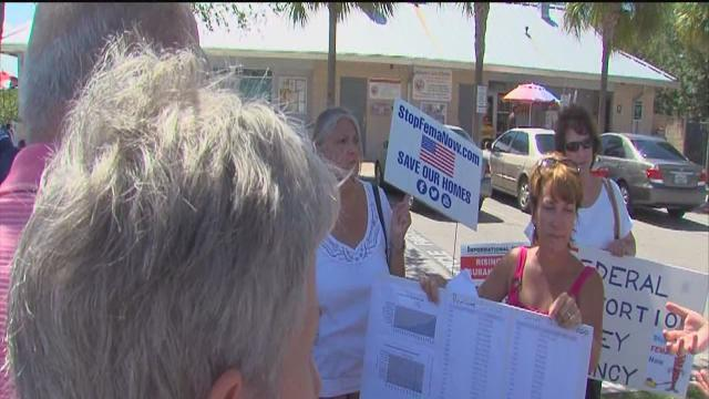 Homeowners rally against flood insurance rate increases