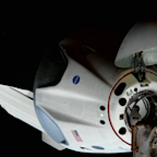SpaceX Nasa Mission: Astronaut capsule docks with space station