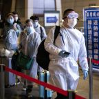 Asia virus latest: Wuhan travel ban lifted, Japan under state of emergency