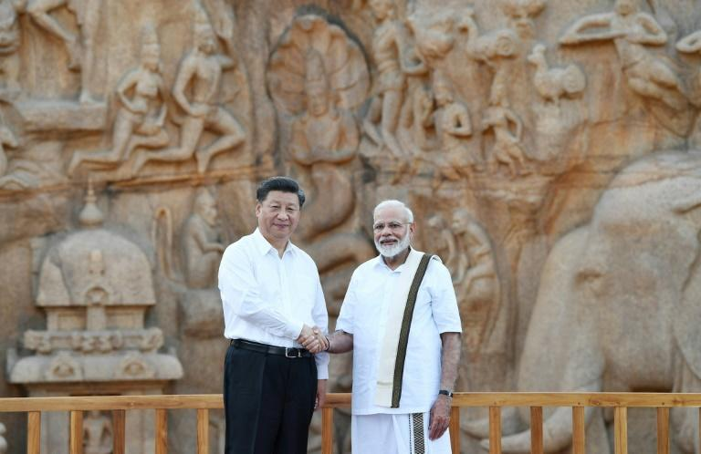 Indian Prime Minister Narendra Modi (R) shakes hands with Chinese President Xi Jinping ahead of their informal summit, but their two countries have never been the best of friends (AFP Photo/Handout)