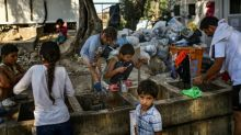 Greece vows to improve conditions on island migrant camps
