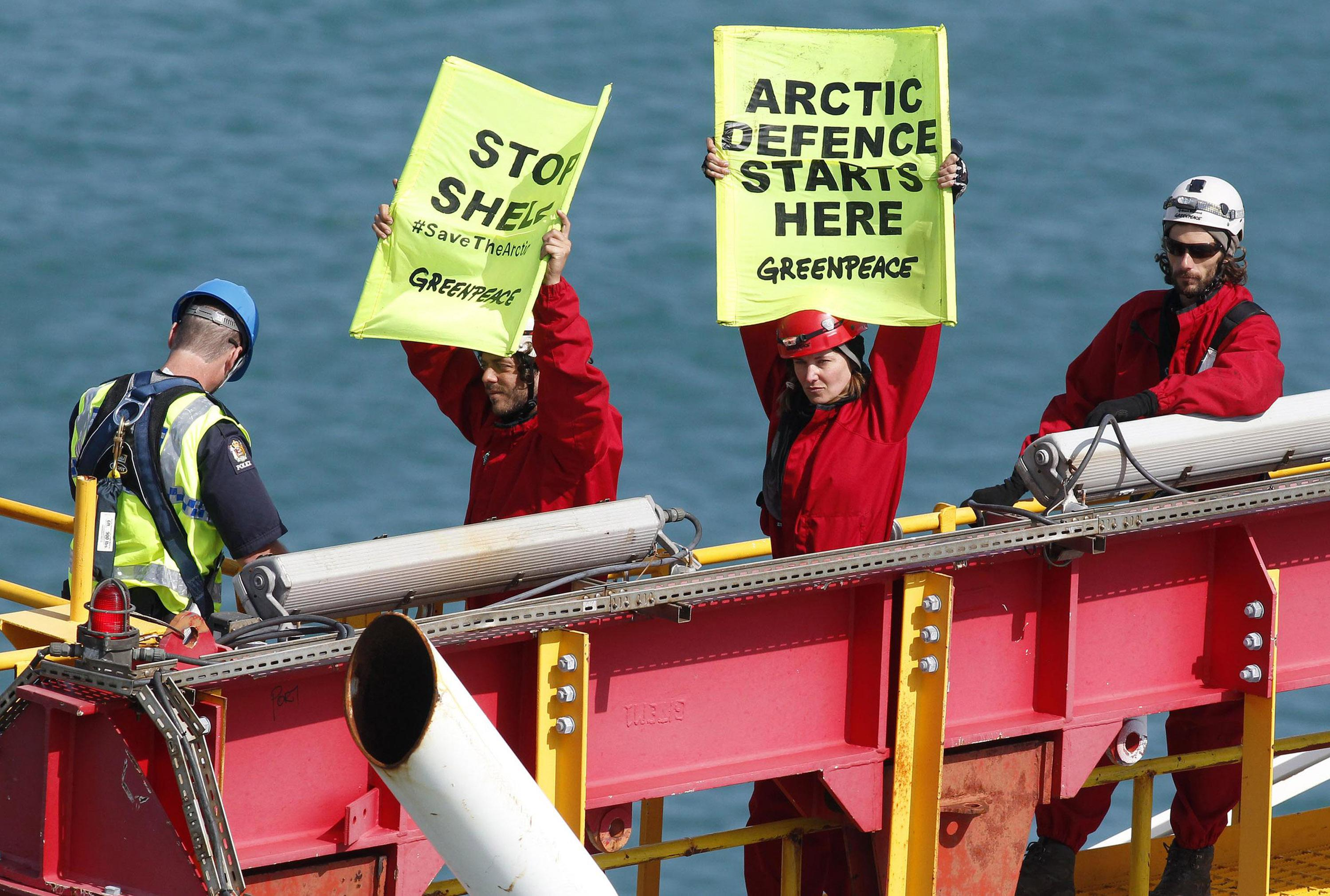 In this photo released by Greenpeace, actress Lucy Lawless and five Greenpeace activists are arrested by police atop a 174-foot (53-meter) drilling tower on the Noble Discoverer in Port Taranaki, New Zealand, on Monday, Feb. 27, 2012. Police on Monday arrested Lawless and the activists after the group spent four days protesting aboard the oil-drilling ship docked in New Zealand. (AP Photo/Greenpeace, Nigel Marple) NO SALES, NO ARCHIVES, EDITORIAL USE ONLY, MANDATORY CREDIT