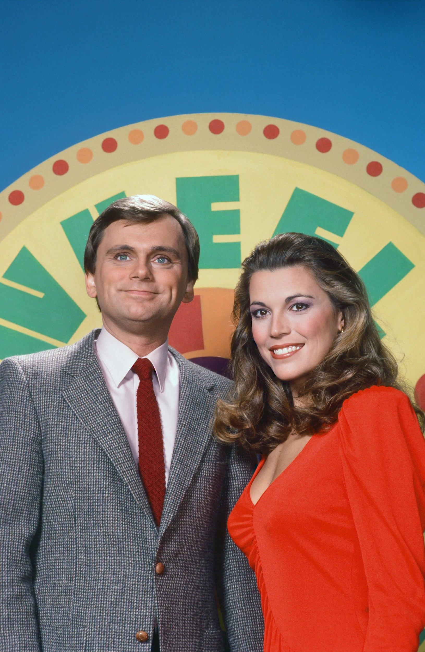 WHEEL OF FORTUNE -- Season 10 -- Pictured: (l-r) Host Pat Sajak, hostess Vanna White -- Photo by: Herb Ball/NBCU Photo Bank