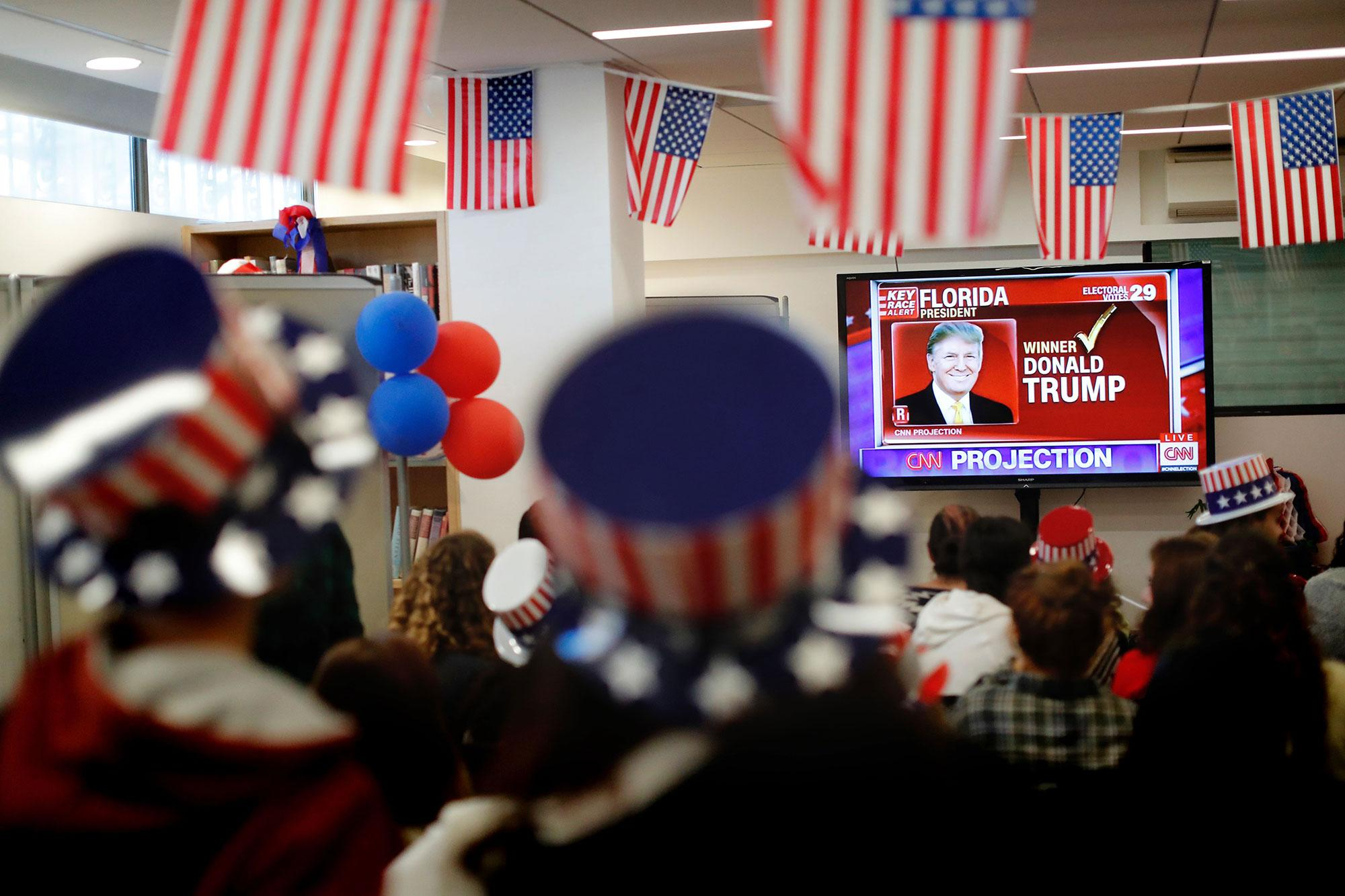 <p>Israelis follow the US presidential elections on TV at the American Center in Jerusalem on November 9, 2016. Billionaire populist Donald Trump, tapping into an electorate fed up with Washington insiders, was on the verge of a shock victory Wednesday over Hillary Clinton in a historic US presidential election that sent world markets into meltdown. (Photo: Thomas Coex/AFP/Getty Images) </p>