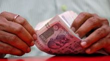Indian rupee posts first quarterly fall in four as dollar rallies