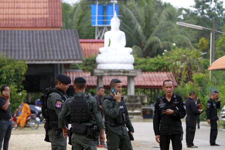 Military police officers are seen at a temple where unknown gunmen shot dead two Buddhist monks and injured two others on Friday in Su-ngai Padi district in the southern province of Narathiwat, Thailand, January 19, 2019. REUTERS/Surapan Boonthanom