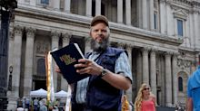 St Paul's stop preacher from read The Bible outside Cathedral