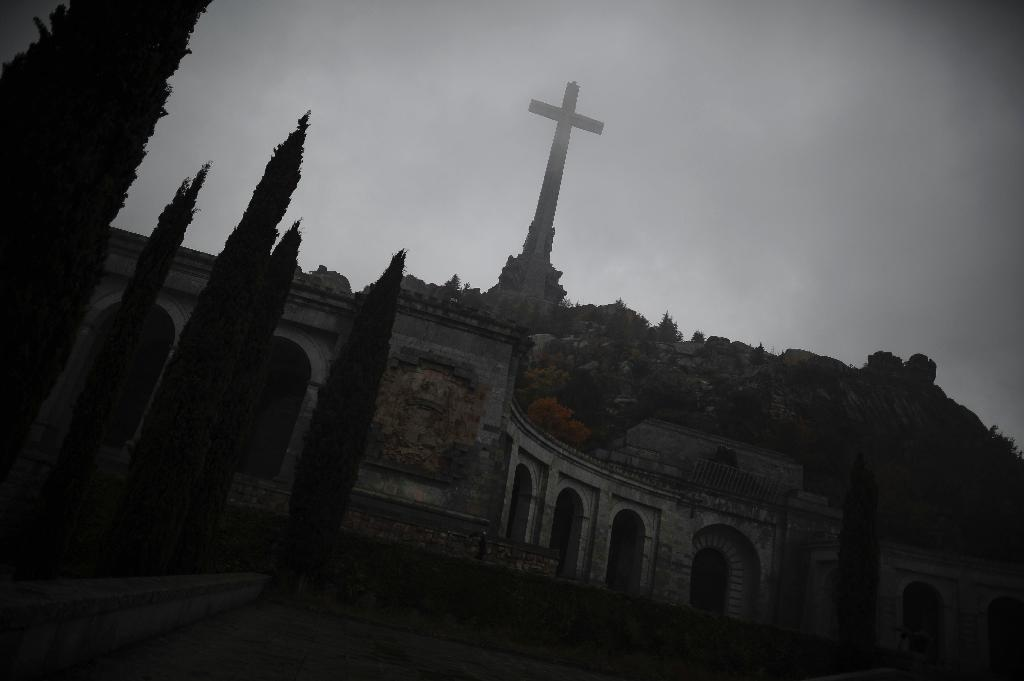 Built by Franco's regime between 1940 and 1958 in the granite mountains of the Sierra de Guadarrama, the Valley of the Fallen holds the remains of over 30,000 dead from both sides in Spain's civil war (AFP Photo/Pedro Armestre)