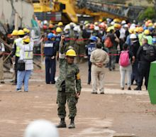 Rescue workers race to find survivors at collapsed Mexico City school