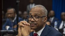 Haitian prime minister Jack Guy Lafontant resigns after fuel price hike triggers deadly riots