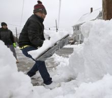 Photos: Deadly winter storm blankets Midwest, Northeast, knocks out power, grounds flights