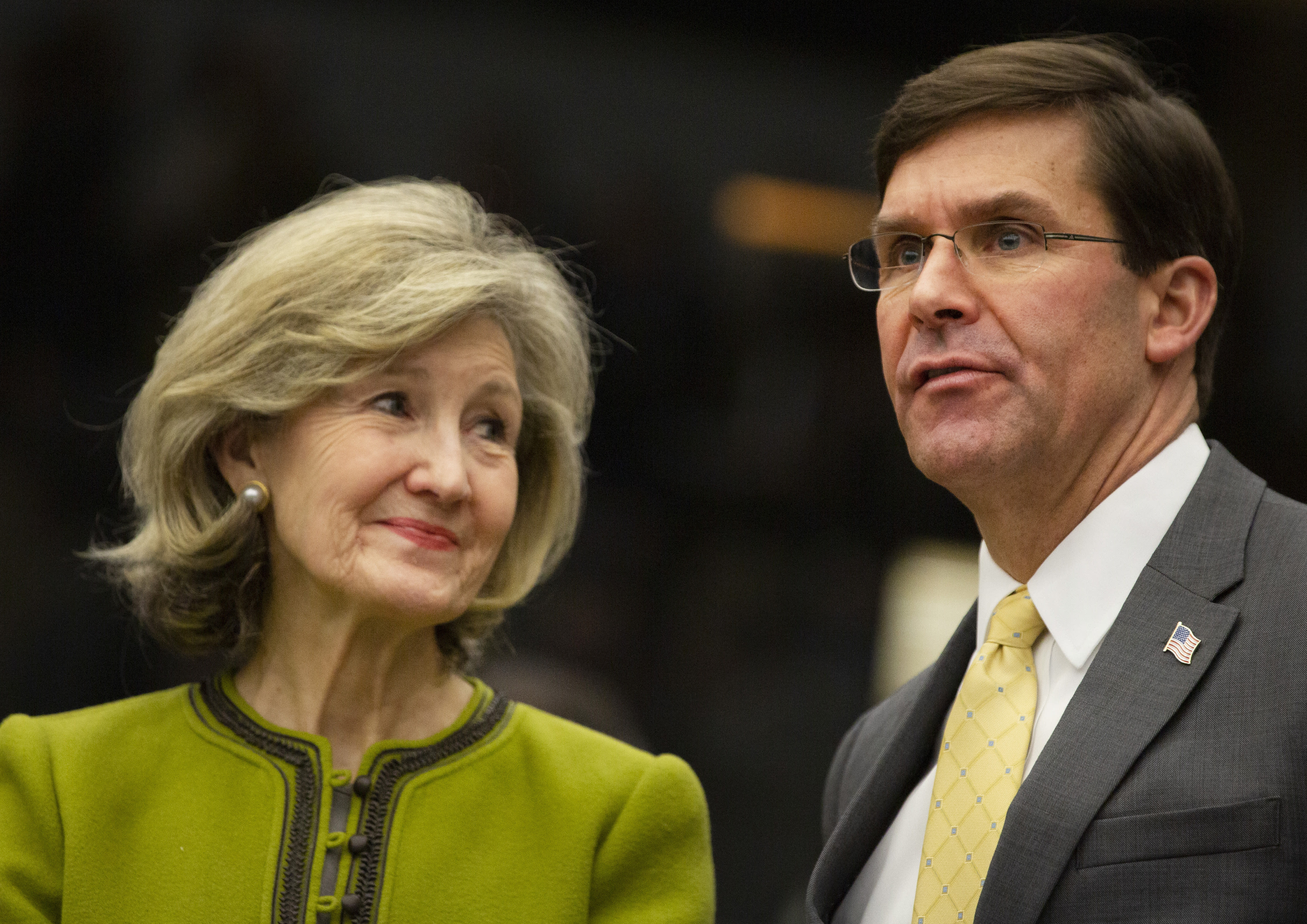 U.S. Secretary for Defense Mark Esper, right, speaks with U.S. Ambassador to NATO Kay Bailey Hutchison during a meeting of the Resolute Support Mission at NATO headquarters in Brussels, Thursday, Feb. 13, 2020. NATO ministers, in a second day of meetings, will discuss building stability in the Middle East, the Alliance's support for Afghanistan and challenges posed by Russia's missile systems. (AP Photo/Virginia Mayo)
