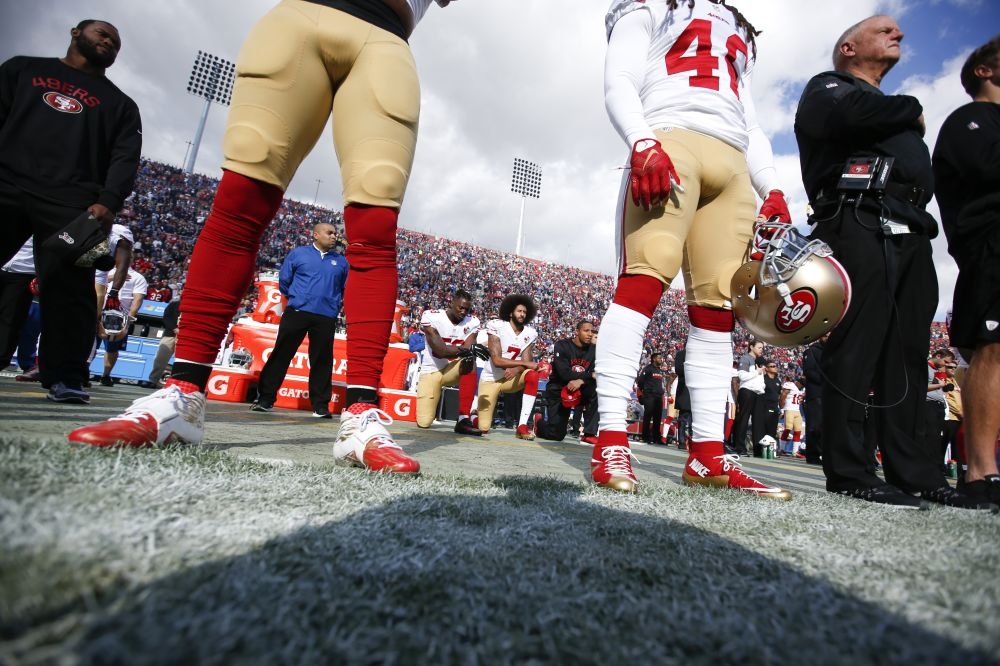 Colin Kaepernick is on the outside looking in at the NFL. (Getty Images)