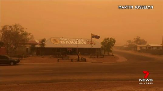 Image result for Eerie orange dust cloud sweeps across the town of Birdsville.