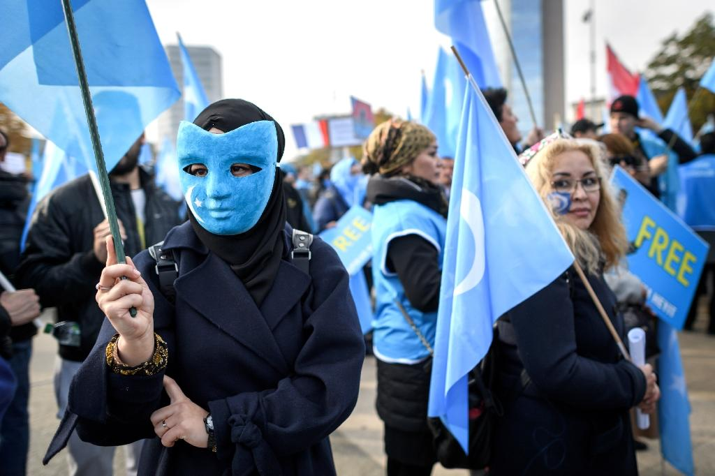 Uighurs demonstrate against China outside the UN offices in Geneva -- a recent UN report said as many as one million ethnic Uighurs are being kept in extrajudicial detention in China's Xinjiang region (AFP Photo/Fabrice COFFRINI)
