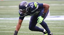 Carlos Dunlap came back to Seahawks because Russell Wilson said he's 'here to stay'