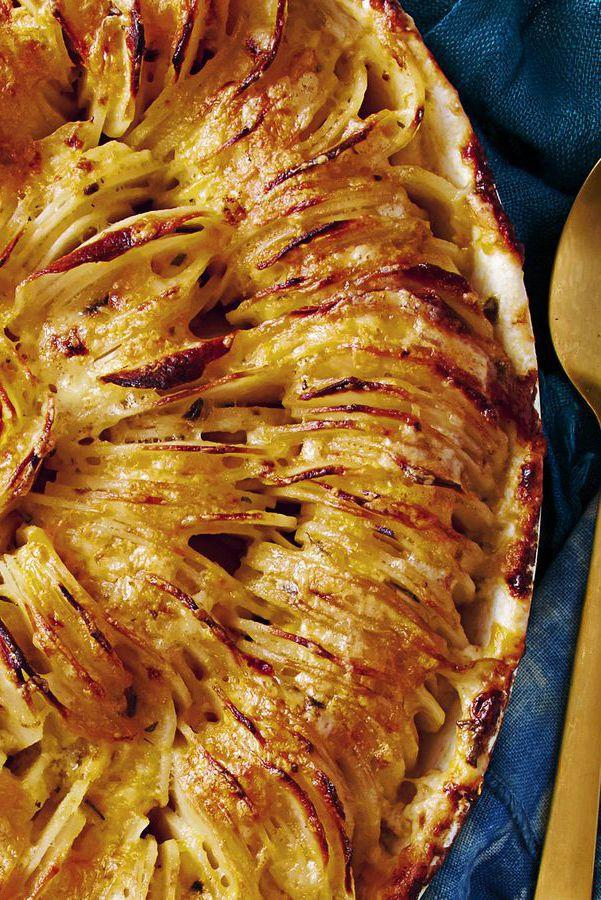 "<p>Fancy-up your go-to side dish with this cheesy scalloped potato recipe. </p><p><strong>Get the recipe at <a href=""https://www.goodhousekeeping.com/food-recipes/a37459/scalloped-hasselback-potatoes-with-cheddar-recipe/"" rel=""nofollow noopener"" target=""_blank"" data-ylk=""slk:Good Housekeeping."" class=""link rapid-noclick-resp"">Good Housekeeping. </a></strong><br></p>"