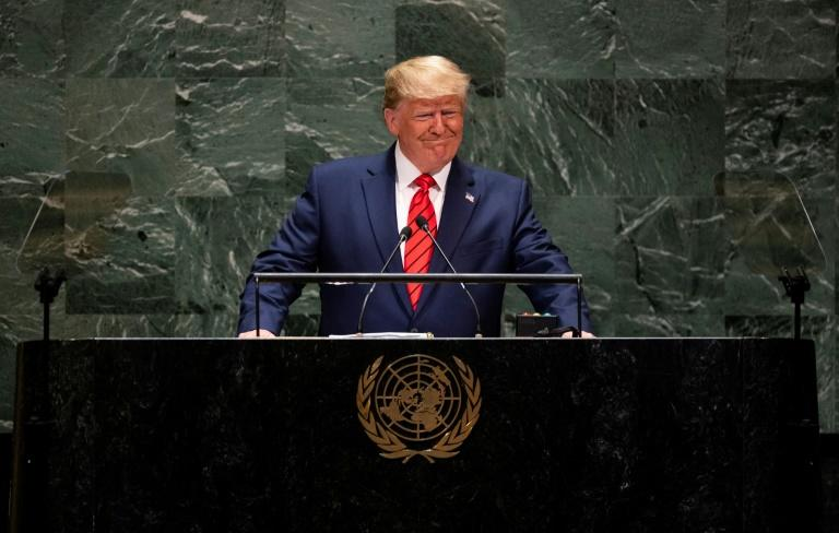 US President Donald Trump is seen here addressing the UN General Assembly in September 2019 -- the United States is one of the dozens of countries behind on their UN dues (AFP Photo/Johannes EISELE)