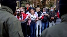 Belarus protesters keep pressure on Lukashenko with mass rallies and police data leak
