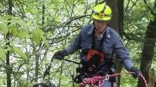 Dog stuck on 400-foot cliff rescued by cop using ropes