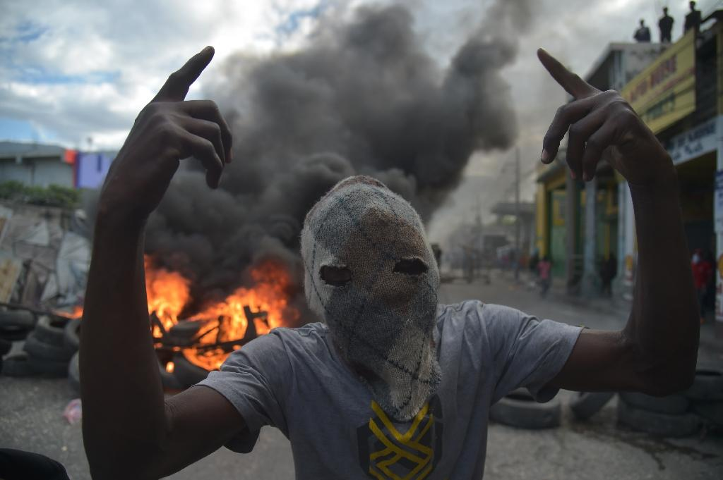 Violent footage beamed worldwide has sent the message impoverished Haiti is no place to go on holiday (AFP Photo/HECTOR RETAMAL)