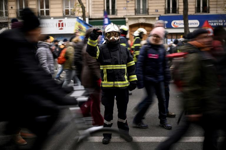 Claire, a 32-year-old firefighter is demanding better staffing (AFP Photo/Lionel BONAVENTURE)