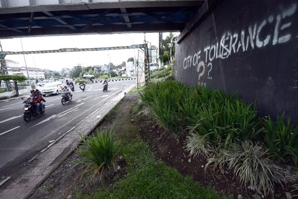 A graffiti calling for tolerance in Yogyakarta, Indonesia (AFP Photo/Goh Chai Hin)