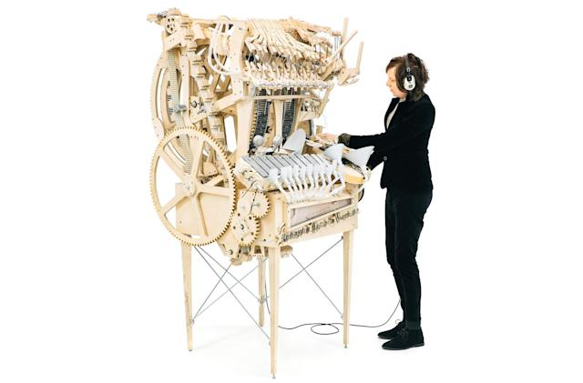 Incredibly complex machine plays music with marbles