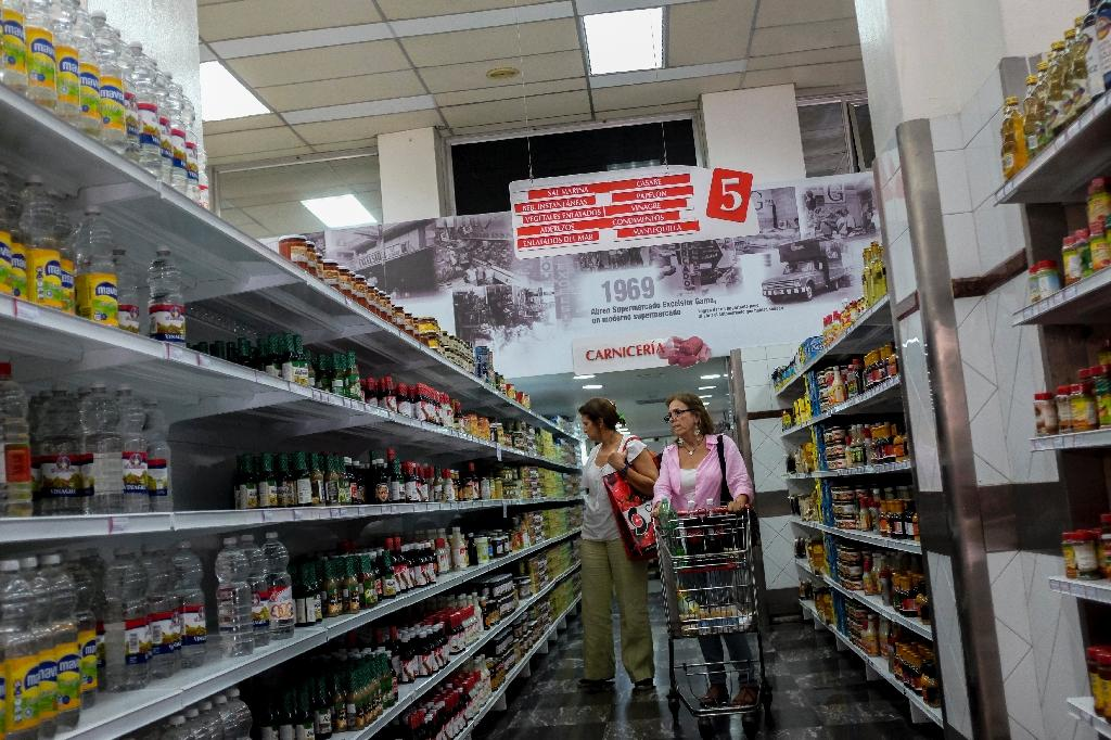 Recently the Venezuelan government has begun to relax its price control system, allowing food sales at market prices in several states and to a limited extent in Caracas (AFP Photo/Federico Parra)