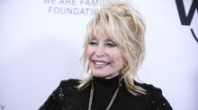 Dolly Parton has multiple flower and butterfly tattoos to 'cover scars'