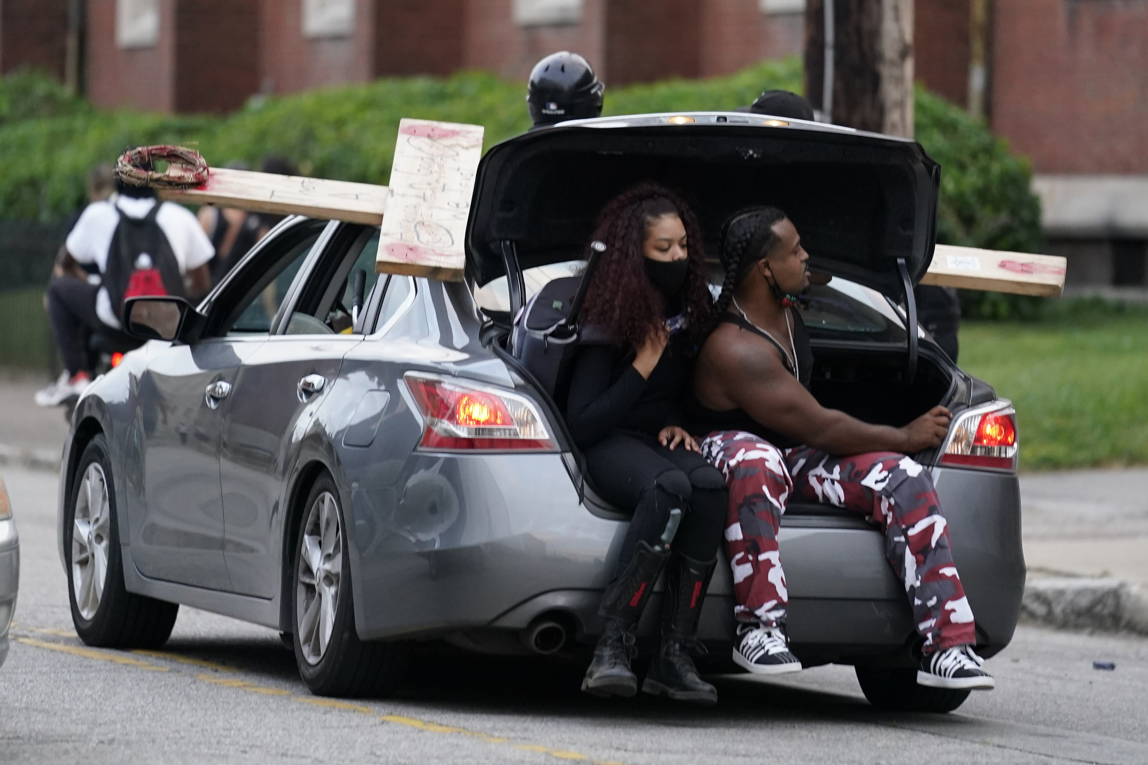 The Latest Protesters Outside Louisville Church Amid Curfew