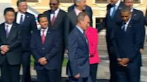 Fractious G20 smile thinly for family photo