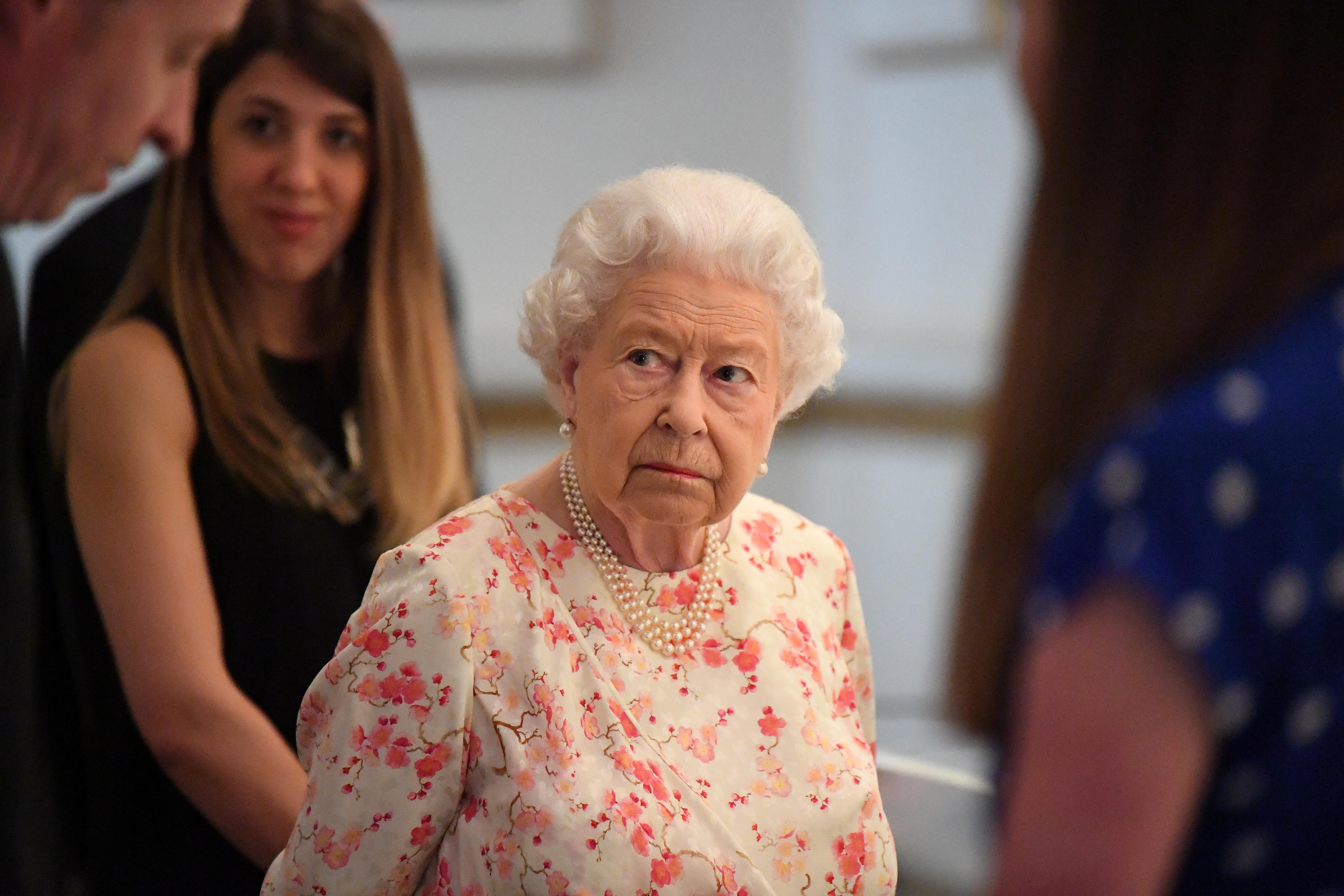 Britain's Queen Elizabeth II attends a special exhibition celebrating the 200th anniversary of the birth of Queen Victoria which marks this year's Summer Opening of Buckingham Palace in London, Britain, July 17, 2019. Victoria Jones/Pool via REUTERS
