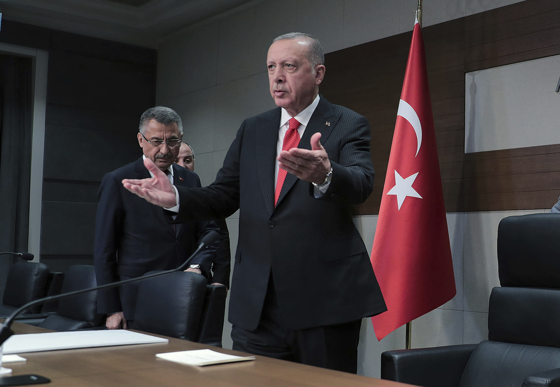 Turkey's President Recep Tayyip Erdogan speaks to the media before traveling to Azerbaijan, in Istanbul, Monday, Oct. 14, 2019. Erdogan has criticized NATO allies which are looking to broaden an arms embargo against Turkey over its push into northern Syria. (Presidential Press Service/Pool Photo via AP)