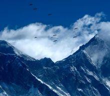 Coronavirus: Chinese explorers start Everest climb amid pandemic