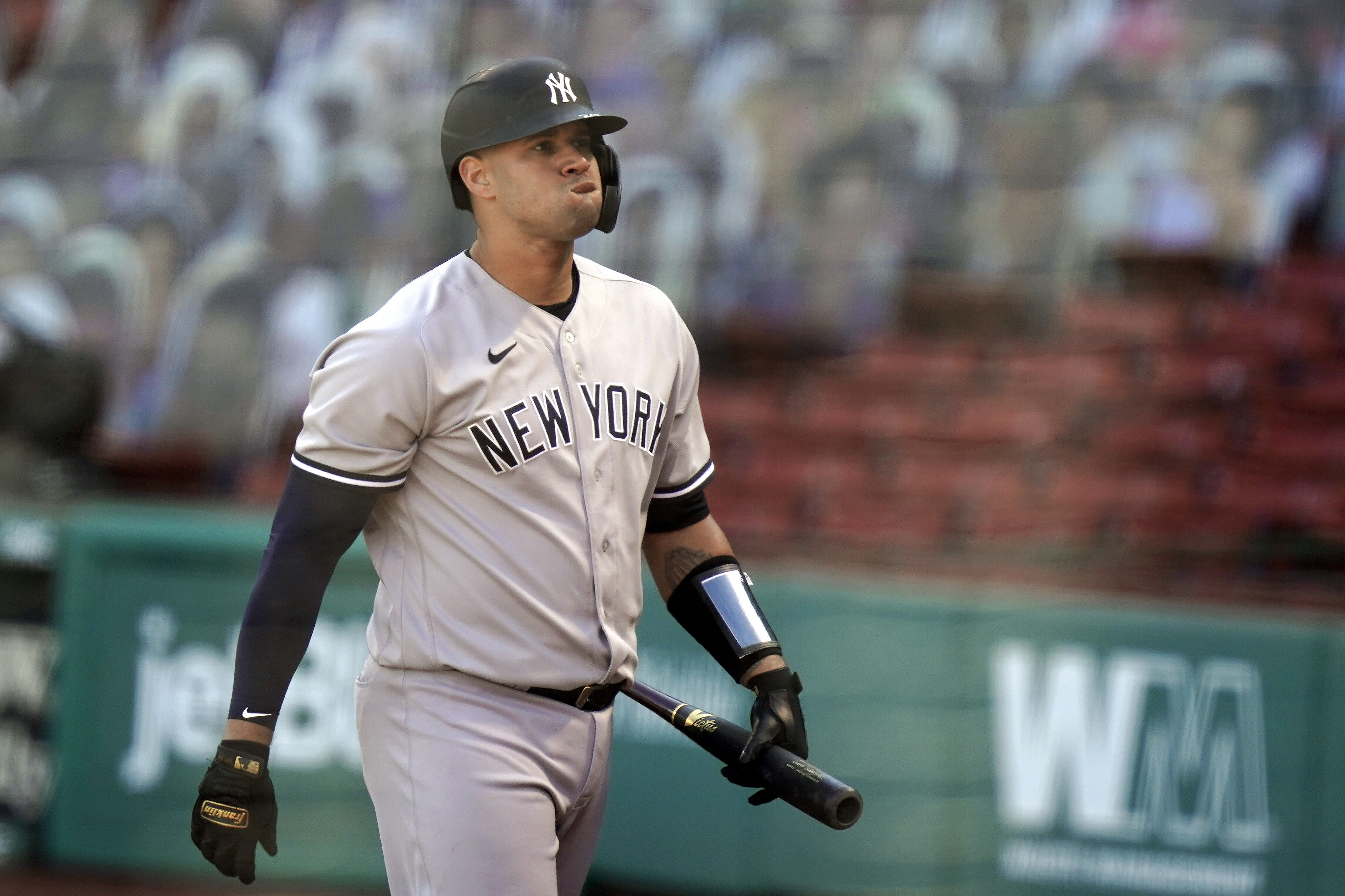 New York Yankees' Gary Sanchez reacts after he struck out swinging in the fifth inning of a baseball game against the Boston Red Sox, Sunday, Sept. 20, 2020, in Boston. (AP Photo/Steven Senne)