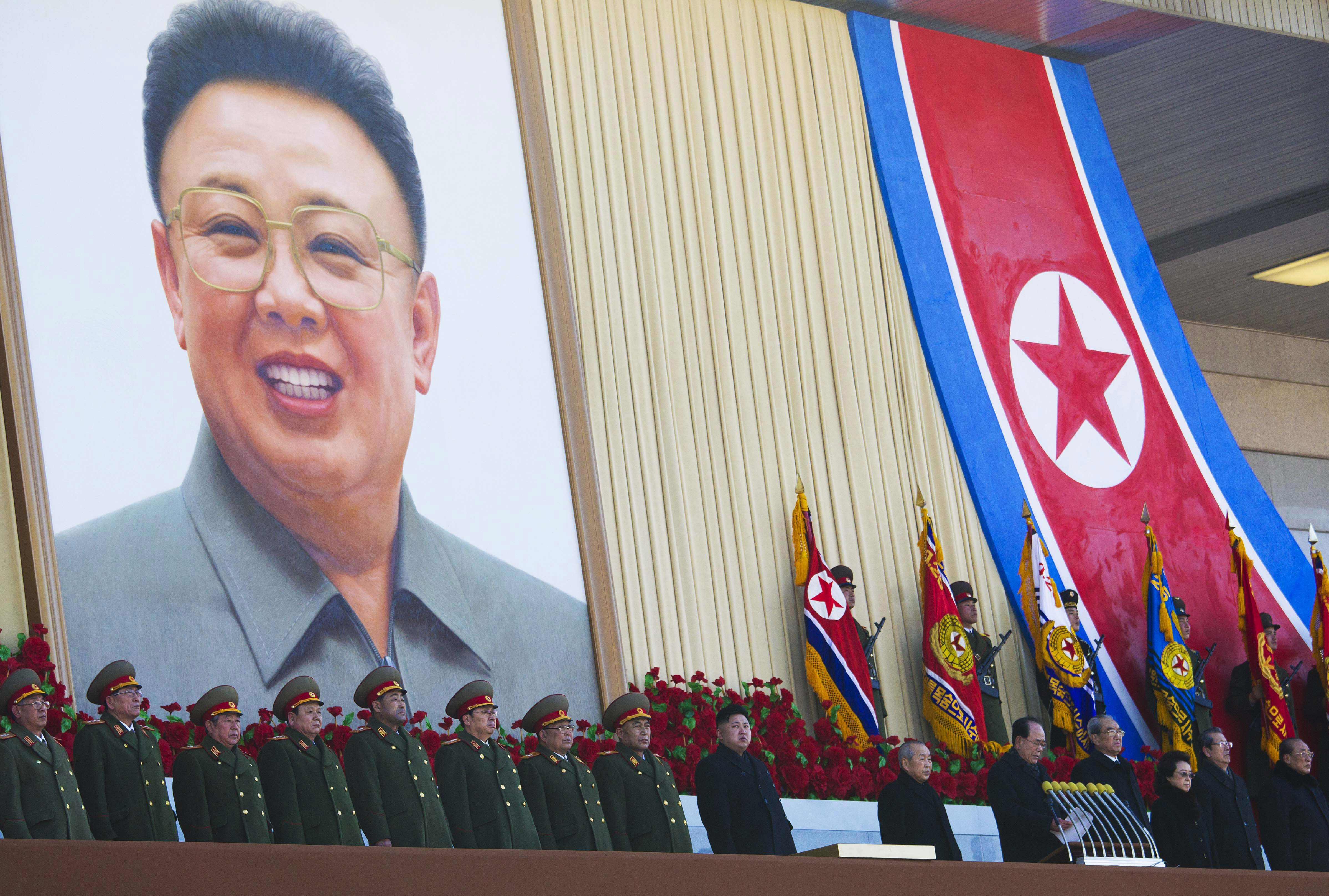 FILE - In this Thursday, Feb. 16, 2012 file photo, New North Korean leader Kim Jong Un, center, and senior political and military leaders, including his aunt, Kim Kyong Hui, third right, stand at attention at Kumsusan Memorial Palace in Pyongyang while reviewing a parade of thousands of soldiers and commemorating the 70th birthday of the late Kim Jong Il, picture in the background. North Korea's propaganda machine has long kept alive the myth of a serene, all-powerful ruling dynasty that enjoyed universal love and support at home. In a single stroke last week, that came crashing down. In attempting to justify the execution of his uncle, who was also considered the North's No. 2 official, young leader Kim Jong Un has given the world a rare look behind the scenes of a notoriously hard-to-read government. (AP Photo/David Guttenfelder, File)