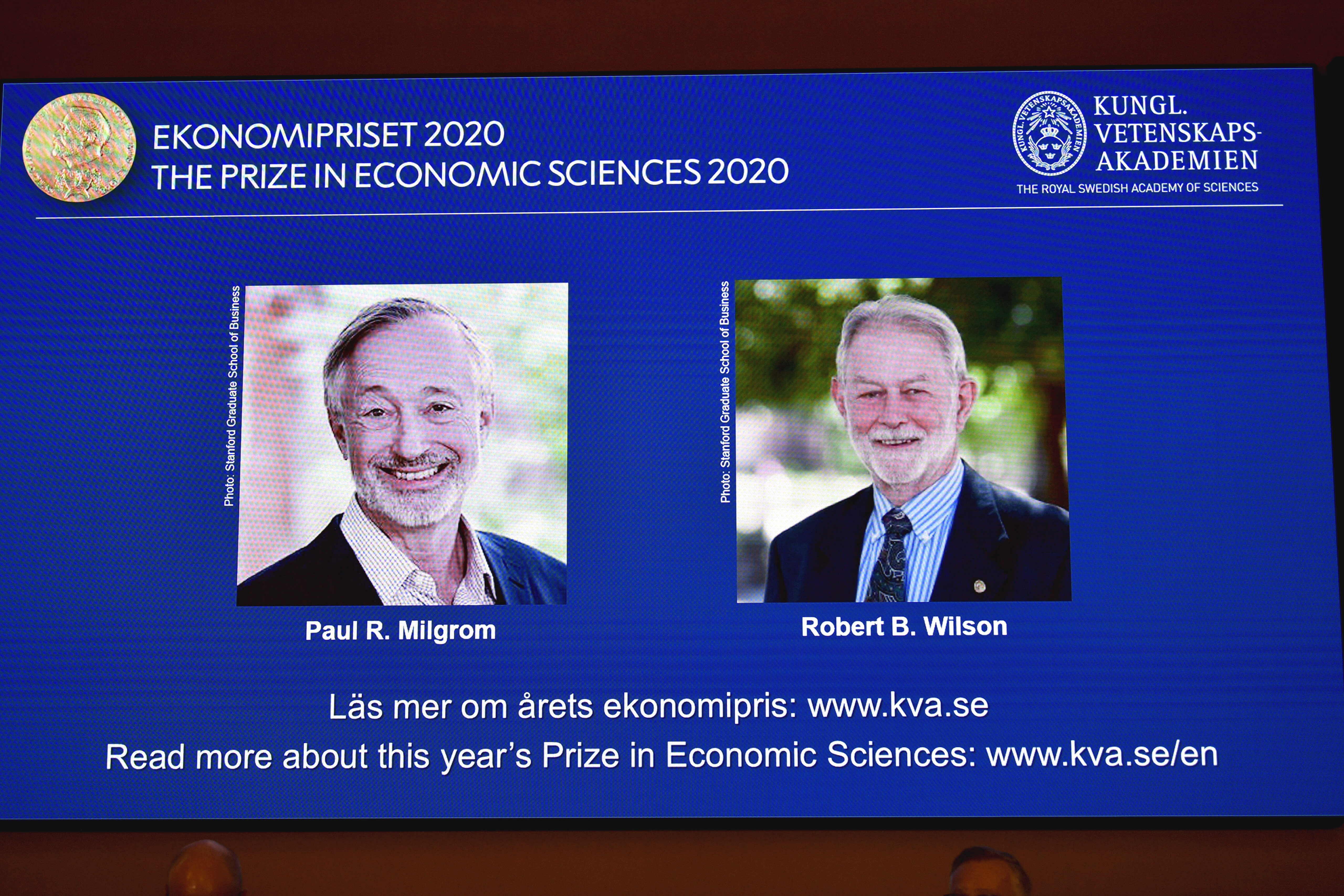 """Winners of the Sveriges Riksbank Prize in Economic Sciences in Memory of Alfred Nobel for 2020 at a press conference in Stockholm, Monday Oct. 12, 2020. Americans Paul R. Milgrom, left, and Robert B. Wilson have won the Nobel Prize in economics for """"improvements to auction theory and inventions of new auction formats."""" (Anders Wiklund/TT via AP)"""