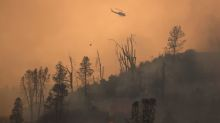 Cooler weather helps battle against California wildfires, four missing