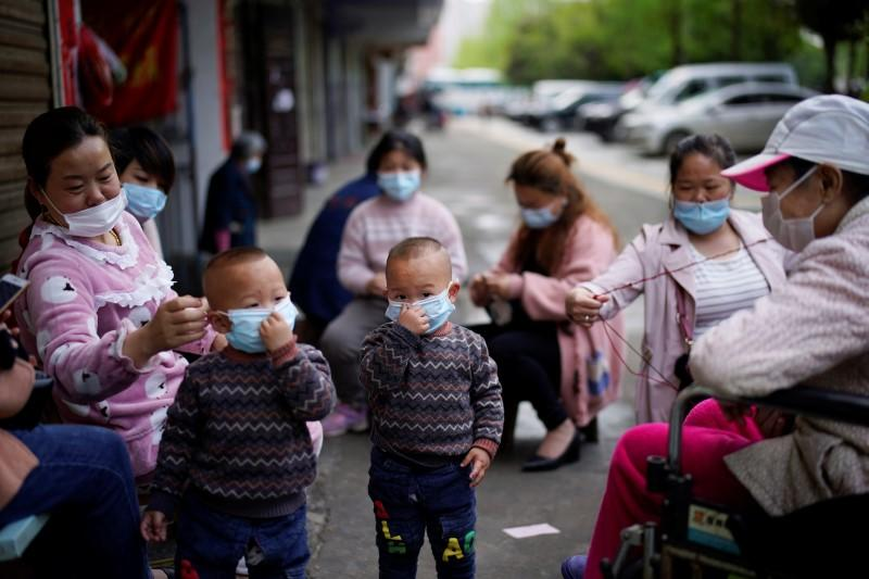 Children and women wearing face masks are seen in Xianning