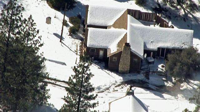 Ex-cop holed up in cabin near sheriff's command center