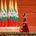 Myanmar leader Suu Kyi departs for genocide hearings amid fanfare at home
