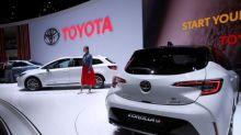 Stronger yen prompts Toyota to trim profit forecast, saps Honda