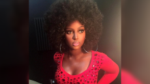 Afro-Latina recording artist accused of 'blackface body' claps back with childhood video